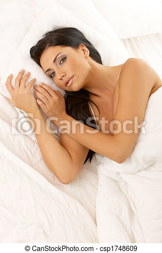 Black haired Beauty in Bed - csp1748609