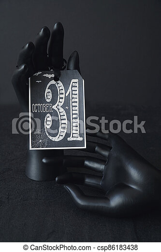 Black hands holding a card - csp86183438