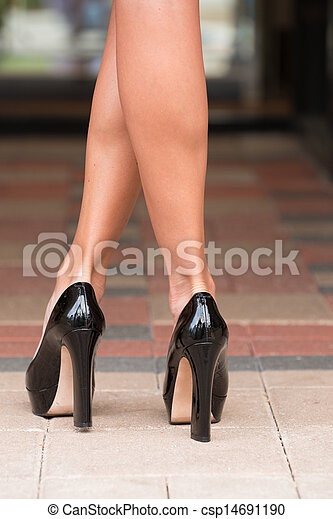 Black High Heels on Paver Block - csp14691190
