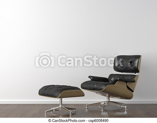 black leather armchair on white wall - csp6008490