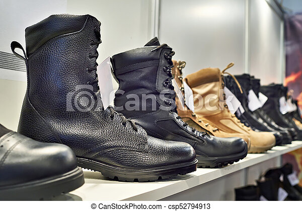 Black leather boots on shelf in store - csp52794913