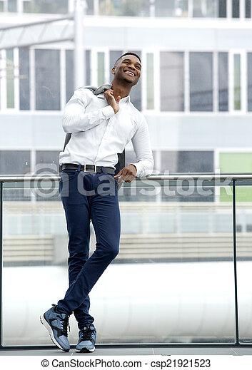 Black male fashion model smiling - csp21921523