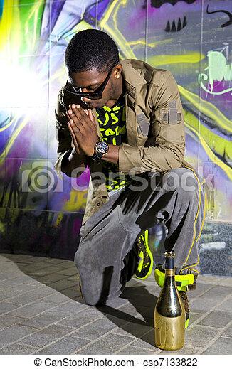 black man offers prayers - csp7133822