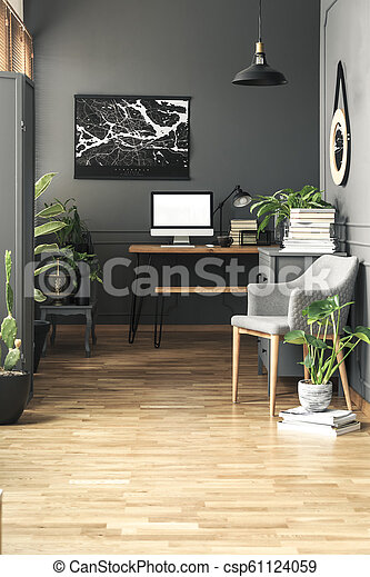 Black painting above desk with mockup of computer desktop in grey freelancer's interior. Real photo - csp61124059