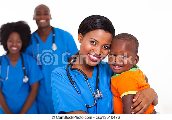 black pediatrician and baby boy with co-workers on background - csp13510476
