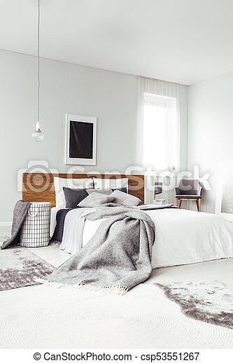 Black poster in bright bedroom - csp53551267