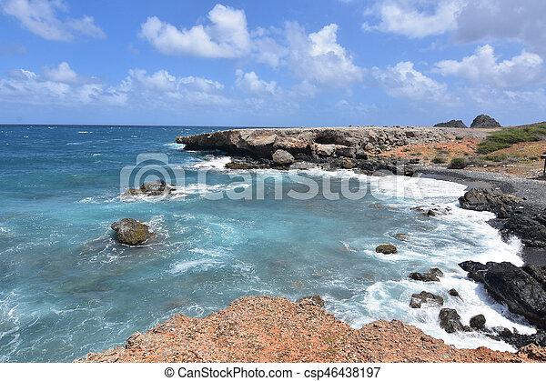 Black Sand Stone Beach on Aruba's East Coast - csp46438197