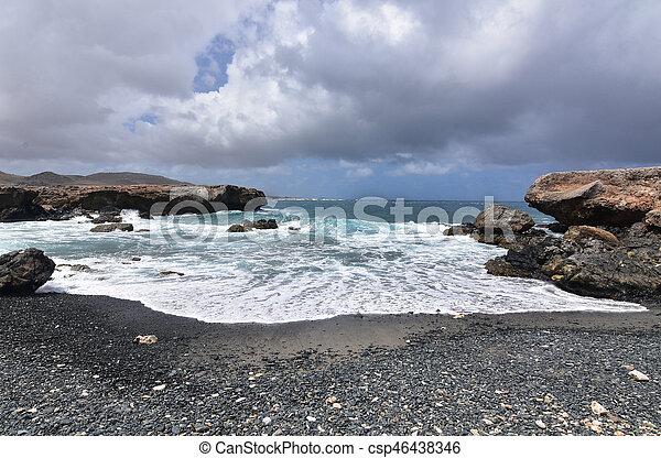 Black Sand Stone Beach on Aruba's Eastern Shore - csp46438346