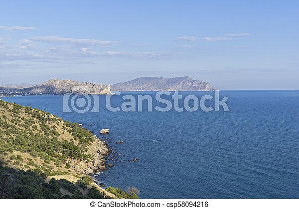Black Sea coast in the rays of the evening sun. - csp58094216