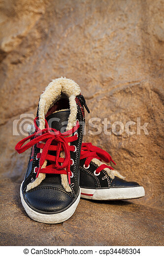 Black sneakers with red laces outdoor