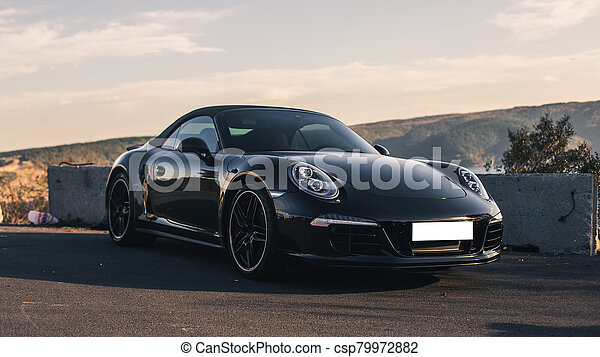 Black sport coupe parking on the road - csp79972882