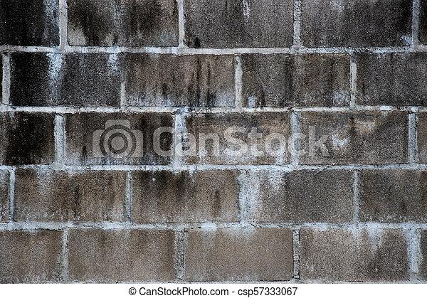 Black stain on white brick concrete wall background - csp57333067