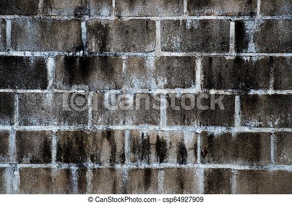 Black stain on white brick concrete wall background - csp64927909