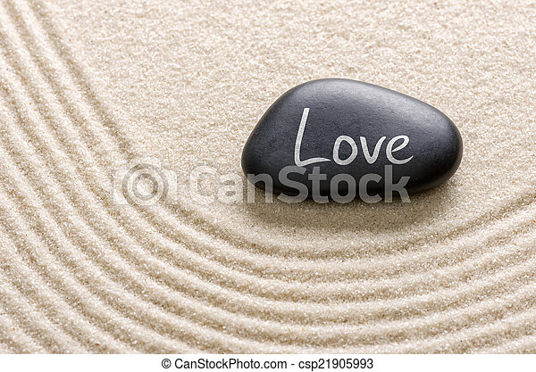 Black stone with the inscription Love - csp21905993