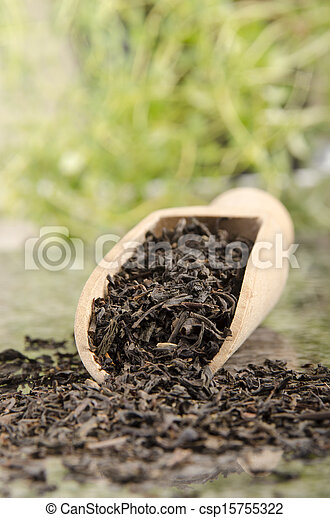 black tea on a wooden shovel - csp15755322