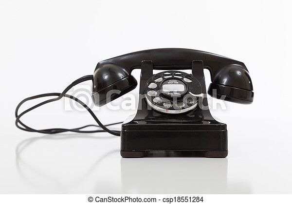 Black, vintage rotary phone on  white - csp18551284