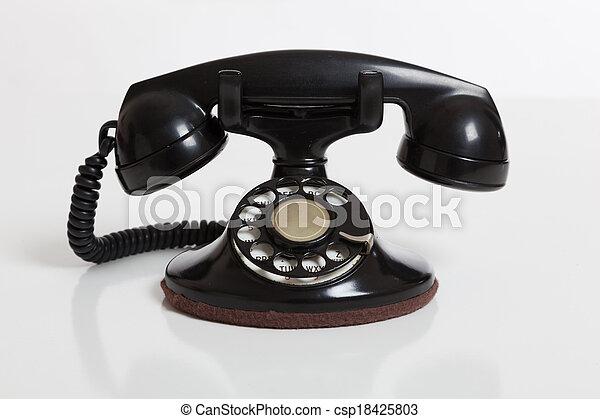 Black, vintage rotary phone on  white - csp18425803