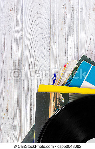 Black vinyl records on the wooden table, selective focus with copy space. Top view - csp50043082