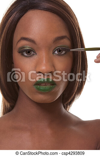 black woman advertising exotic green makeup young female