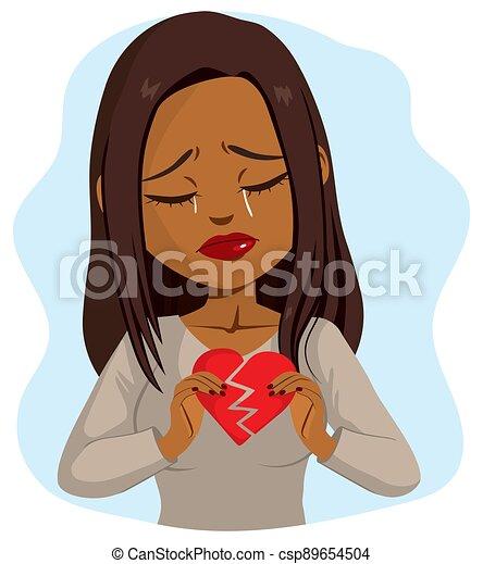 Black Woman Holding Broken Heart - csp89654504