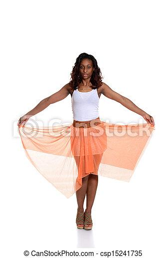 black woman with orange skirt - csp15241735