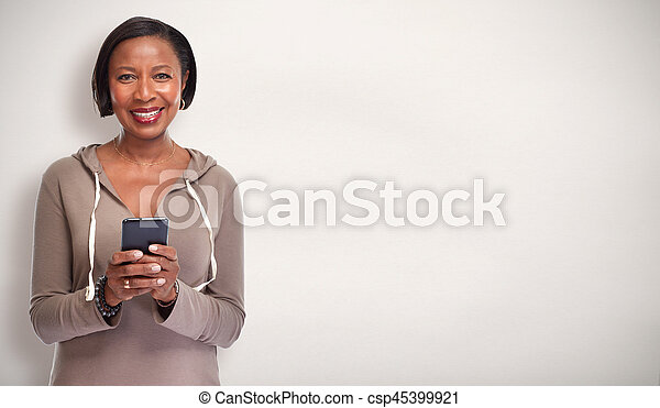 Black woman with smartphone. - csp45399921
