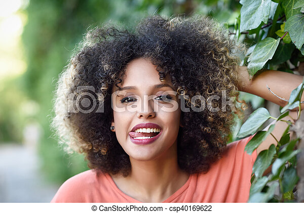 Black Woman With Tongue Out In An Urban Park Young Mixed Girl With