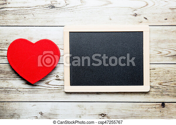 blackboard and heart shaped toy - csp47255767