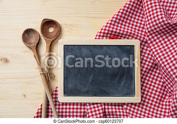 Blackboard And Kitchen Utensils On Red Tablecloth Wooden Table Space For Text Top View