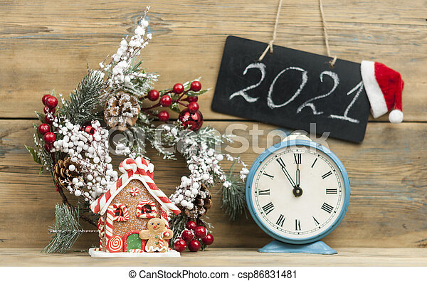 blackboard mock up with Christmas gifts and rustic decorations on wooden background with space for your text - csp86831481