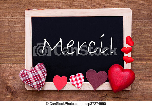 Blackboard With Textile Hearts, Text Merci Means Thank You - csp37274990