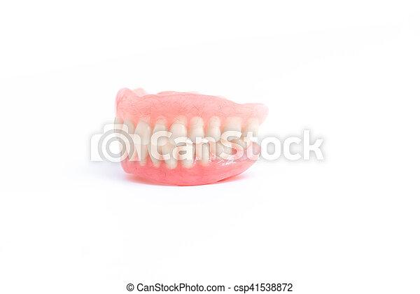 Dentadura postiza completa en fondo blanco - csp41538872