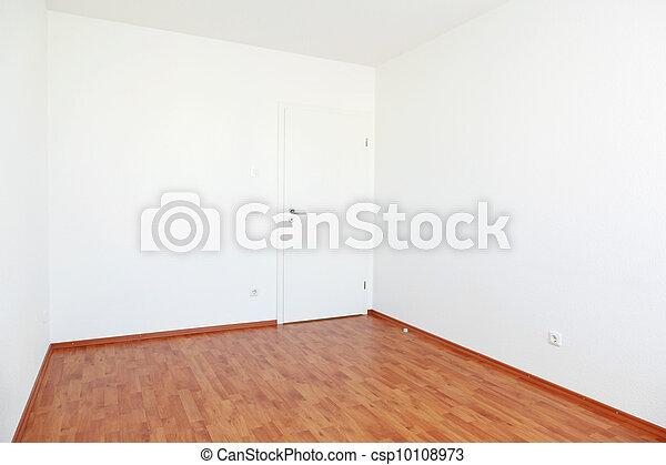 Habitación vacía con puerta blanca - csp10108973