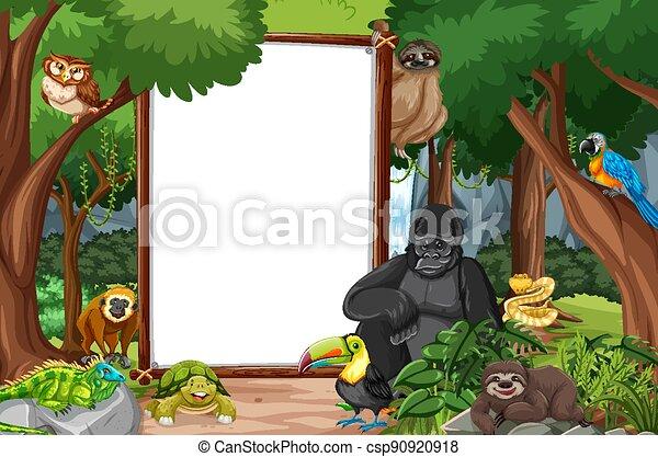 Blank banner in the rainforest scene with wild animals - csp90920918