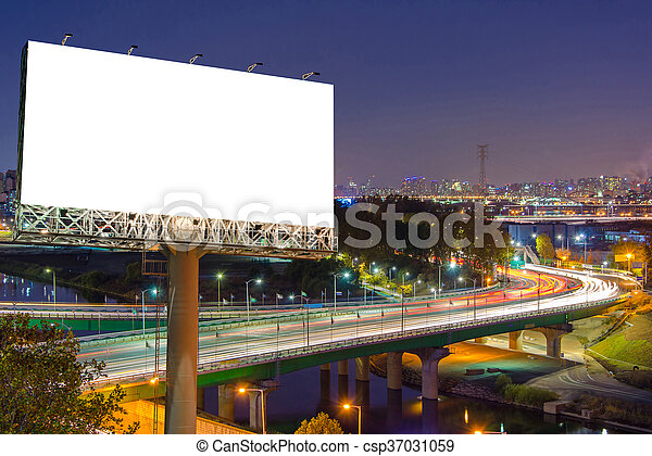 Blank billboard for advertisement in city downtown at night - csp37031059