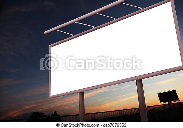 Blank billboard over city background - csp7079553