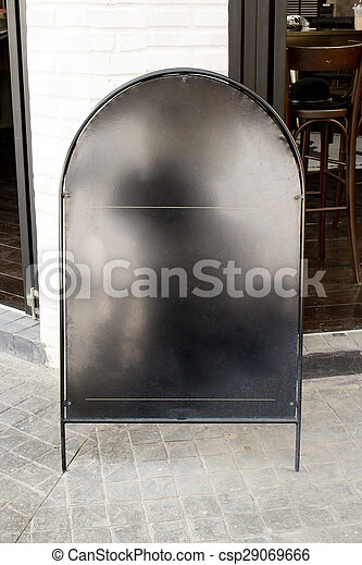 Blank black iron menu board front of cafe - csp29069666