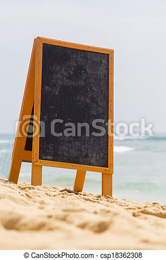 Blank board on the beach - csp18362308