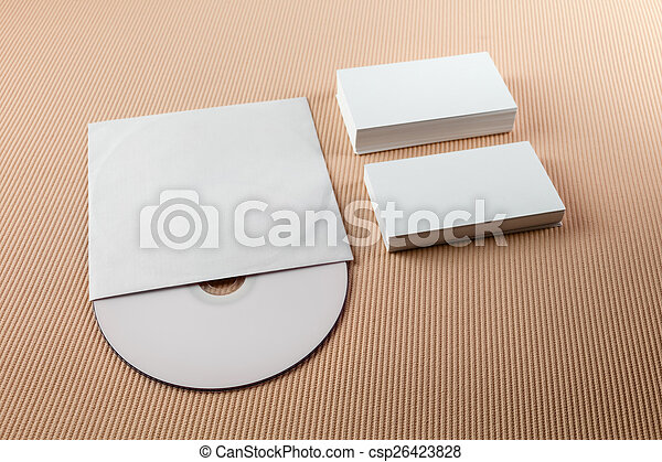 Blank business cards and cd on a beige striped background stock blank business cards and cd csp26423828 reheart Images