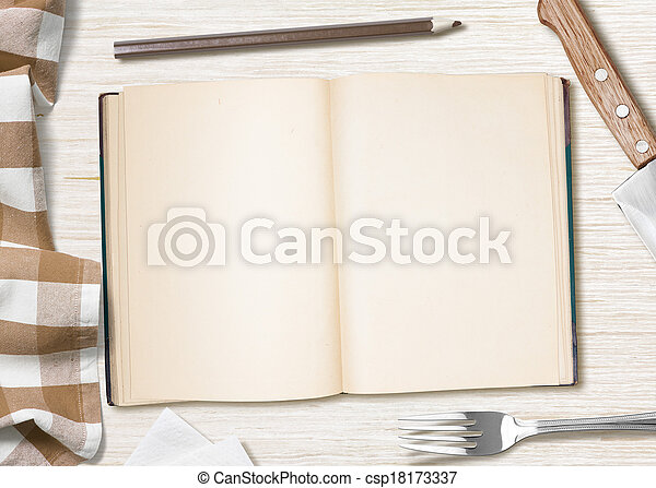 blank cooking recipe notes or book  with pencil on kitchen table - csp18173337