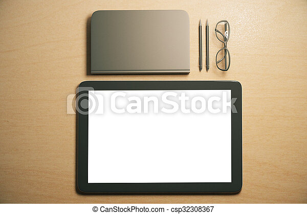 Blank digital tablet screen with diary, pens and eyeglasses on the table, mock up - csp32308367