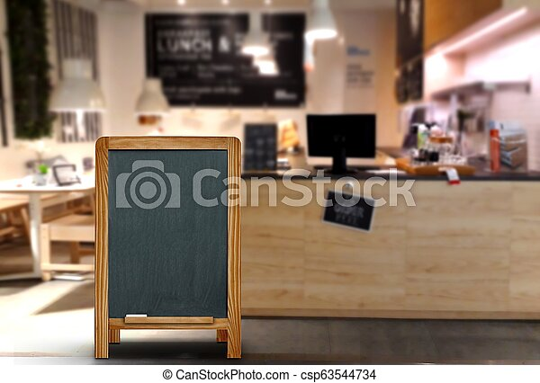Blank menu board stand infront of restaurant with blurred background - csp63544734