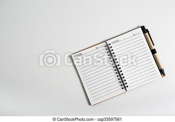 blank notebook with pen and pencil  - csp33597561