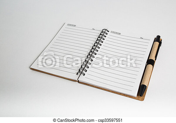 blank notebook with pen and pencil  - csp33597551