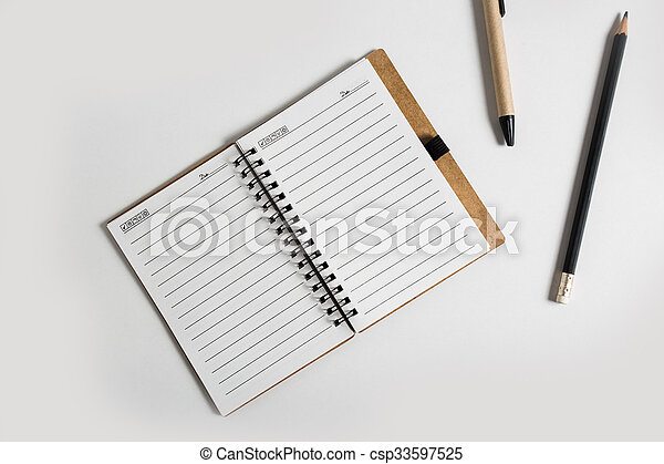 blank notebook with pen and pencil  - csp33597525
