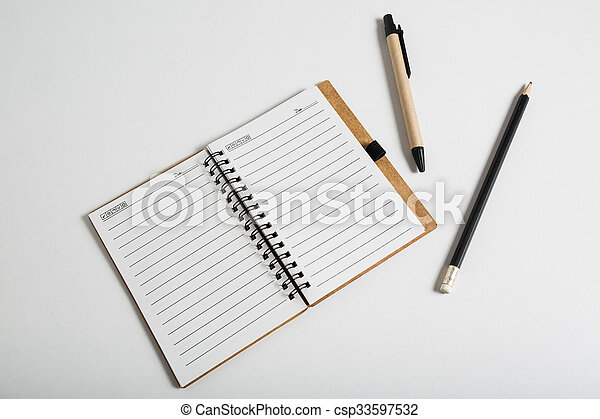 blank notebook with pen and pencil  - csp33597532