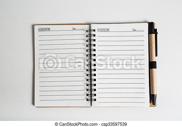 blank notebook with pen and pencil  - csp33597539