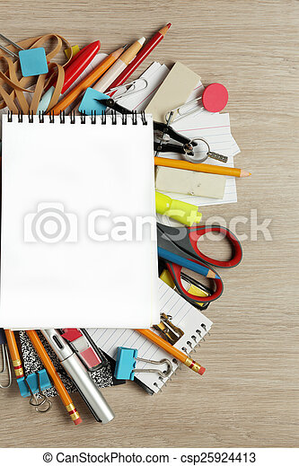 Blank paper on lots of office supplies - csp25924413
