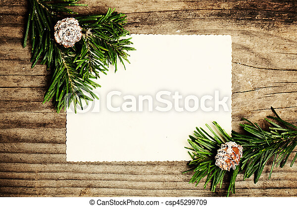 Blank Paper with Fir Branch on Wooden. Christmas Winter Background - csp45299709