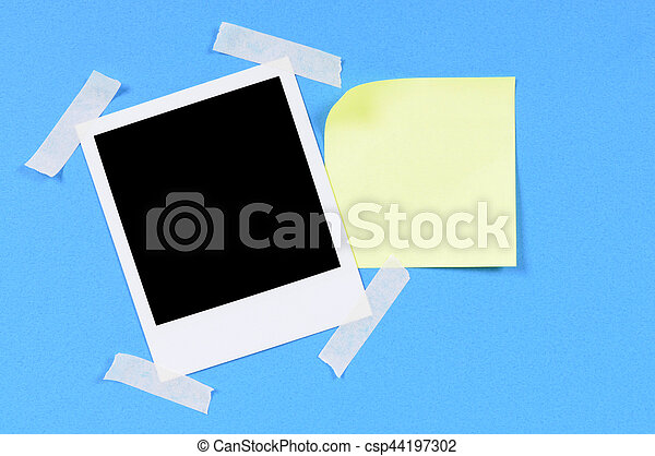 Blank photo print with yellow sticky note - csp44197302